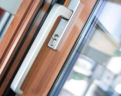 Алюмінієві терасні двері wisniowski. Ручка з ключем